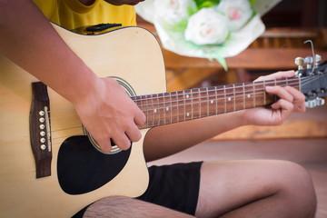 The man playing guitar