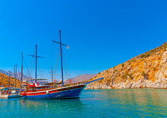 traditional wooden big sailing boat  docked at the port of Vathi village in Kalymnos island in Greece