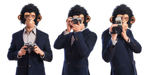 Monkey man photographing over white background