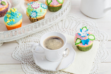 Sweet muffins with sweet decoration and coffee