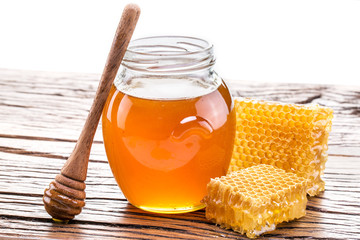 Honeycomb and pot of fresh honey. High-quality picture contains