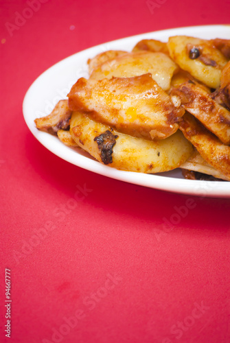 Photo: Octopus with paprika on a white plate, also known as Galician ...