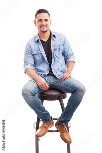 Good Looking Man Sitting In A Chair