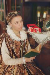 beautiful  girl wearing renaissanse gold  dress
