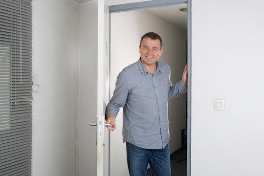 Handsome man opened the door