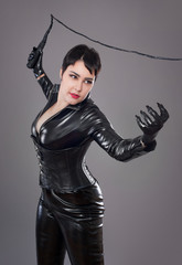 catwoman / Beautiful woman in catwoman leather latex whith whip
