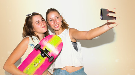 Girls photographing with their skates making a selfie
