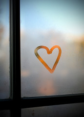 Heart drawn on a foggy window.