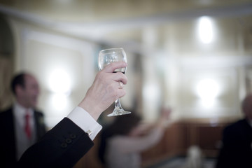 Man in wedding party and glass of red wine