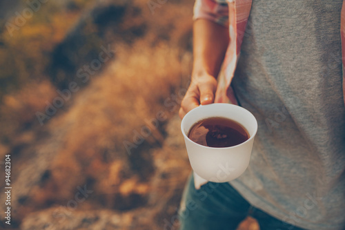 Young Man Holding A Cup With Coffee Outdoors