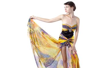 Young female wearing a fashionable yellow silk tie dye dress