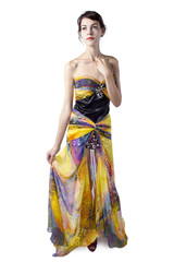 Young female wearing a fashionable yellow silk tie dye dress