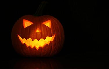 Halloween glowing pumpkin on black background
