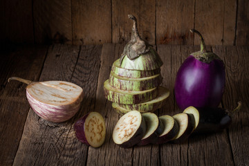Eggplants on a rustic wooden table.