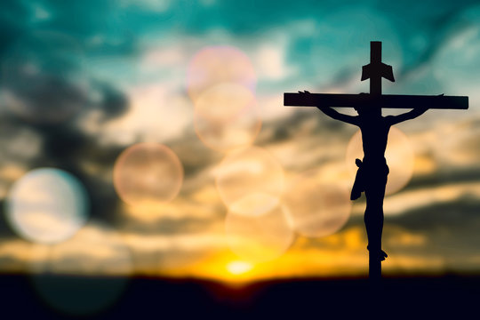 Silhouette of Jesus with Cross over calvary sunset concept for religion, worship, Christmas, Good Friday,  Easter, Jesus he is risen, Thanksgiving prayer and praise, resurrection sunday