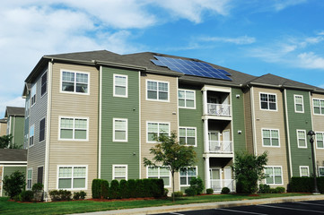 apartment building with solar panel on roof