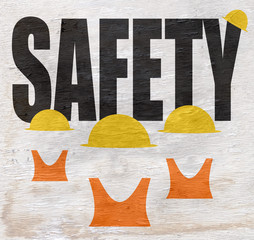 safety design with construction workers with hard hats and vests on wood grain texture