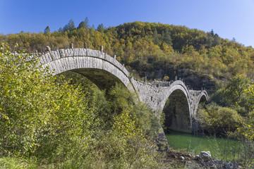 Ioannina Zagoria, Kalogeriko old arch bridge, autumn, river