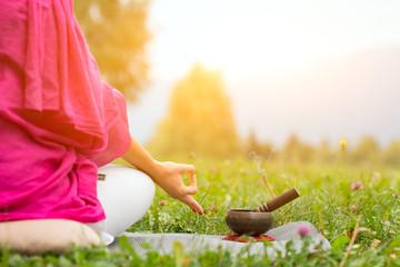 Yoga position with Tibetan bell