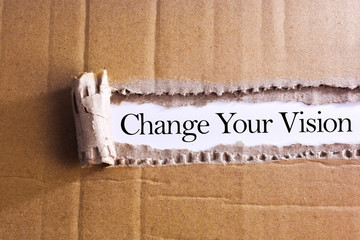 Torn paper box with word Change your vision