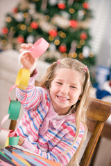 Christmas: Young Girl Proud Of Craft Paper Chain Garland
