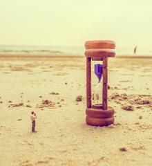mini figure dolls photographer take picture on sandglass