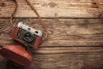 Old vintage camera on the wooden background horizontal
