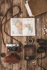 Set of traveler on the wooden background vertical