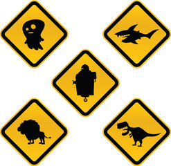 A set of funny cartoon caution signs featuring a ghost, a shark, a robot, a lion and a dinosaur.