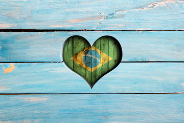 Love Brazil. Heart and flag on a blue wooden board