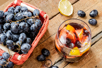 Sangria with ice and black grapes