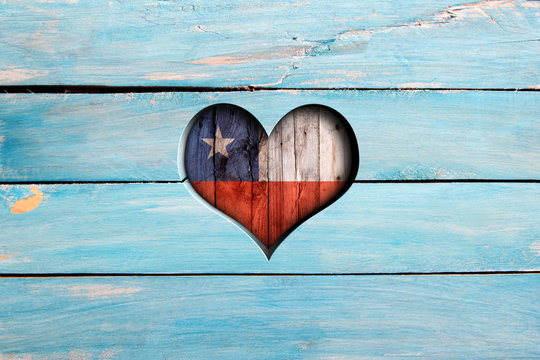 Love Chile. Heart and flag on a blue wooden board
