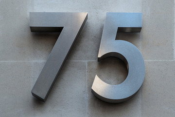 75 number on a building.