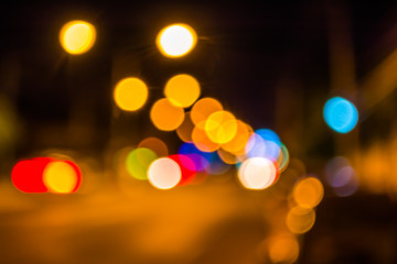 image of blur street bokeh with lights in night time.