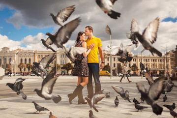 Couple in park with doves