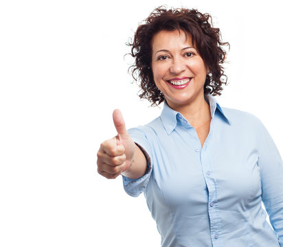 portrait of a mature woman doing a positive gesture on a white background