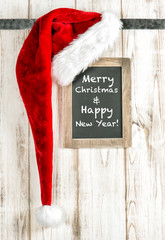 Red Santa hat and vintage chalkboard. Merry Christmas decoration