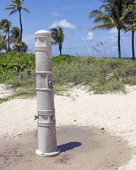 Outdoor Shower on a Fort Lauderdale Beach. One tall cement column that has one shower near the top, and two showers for the lower legs near  on a Fort Lauderdale, Florida beach.