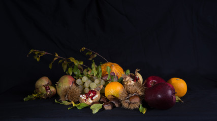 Autumnal still life 1 / Group of autumnal fruits and vegetables on a black background.