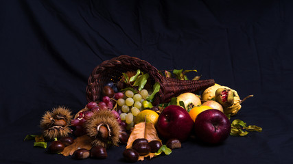 Autumnal still life 2 / Group of autumnal fruits and vegetables on a black background.