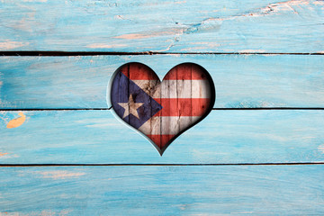 Love Puerto Rico. Heart and flag on a blue wooden board