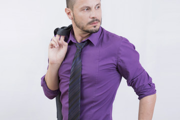 Businessman in purple shirt in studio