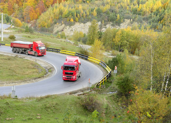 Trucks on the turning road in the mountains