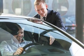 Car dealer with client