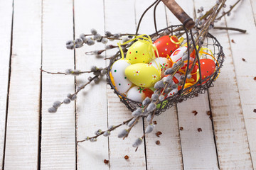 Easter eggs and willow branches in basket