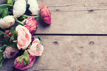 Frame from flowers  on aged  wooden background.