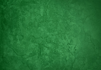 green background, rough texture plaster wall with cracks