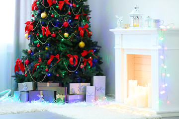 Perfect Christmas tree with gifts underneath in living room