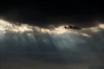 Dark clouds with sunbeams