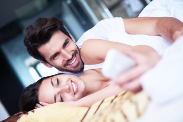 couple relax and have fun in bed